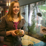 """April 10, 2009 Megan Foster, 12, of Vicksburg and a seventh grader at Vicksburg Middle School, spent last summer volunteering at the Kalamazoo Nature Center and a children's daycare center. """"I want to do either do something with animals or kids,"""" said Foster. At the Nature Center, she often fed the fish and turtles. (Tess McEnroe / Kalamazoo Gazette)"""