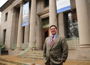 Chris Shires pictured in front of the Holland Historical Trust Museum. Photo courtesy of the Holland Sentinel, 2013.